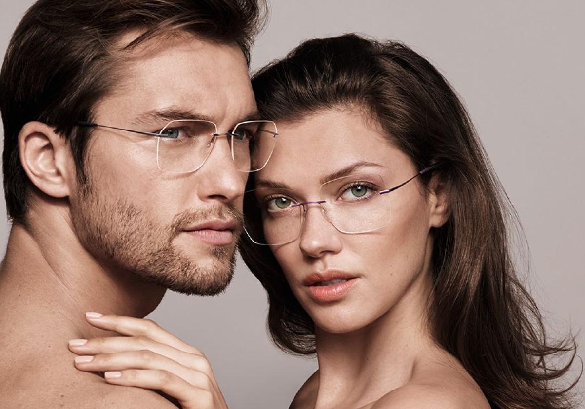 Zwei Silhouette Brillen für Damen und Herren im Gesicht von zwei Menschen.