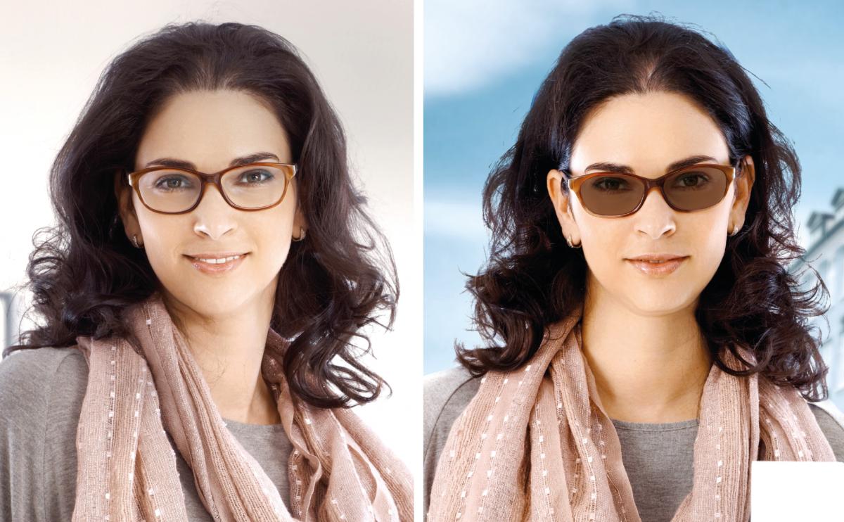 Frau mit selbsttönenden Sonnenbrille und rosa Schal.